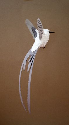 I Make Paper And Wood Birds By Hand-Cutting Every Feather . Bird before painting