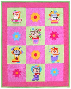 """Cozy Kitties quilt pattern measures 39"""" x 50"""". Can be expanded to 63"""" x 78"""" by adding additional borders. Instructions for both sizes are included. What little girl wouldn't want to snuggle with these cute kitties?!"""