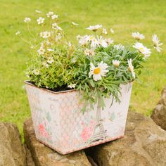 This large square planter is made from zinc and features a vintage style Parisian postcard design featuring a butterfly and roses print perfect for the garden. The print features a distressed edging perfect for adding a touch of shabby chic design to your home or garden. This stylish planter is the perfect way to showcase your favourite flowers and plants and makes an ideal gift for any gardener.