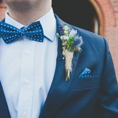 Buttonholes or boutonnieres can be a lovely detail on your wedding day. Image by Ellie Gillard
