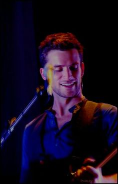 Guy Berryman...it's good he's actually smiling. he's always kind of in his own zone.