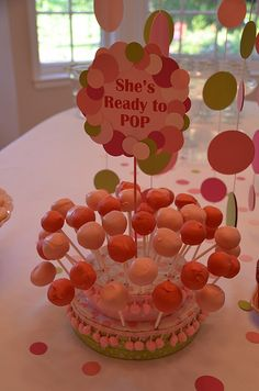 "Circle ""She's about to pop"" Baby Shower. Cake pops on a styrofoam fabric colored stand"