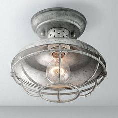 This galvanized steel cage ceiling light is damp-rated for indoor or outdoor use.