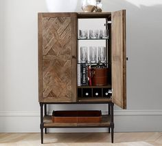 Rustic reclaimed elm gets a fresh spin on the Parquet bar by Pottery Barn; $1,599. potterybarn.com