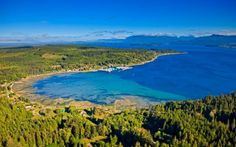 Sointula lines the shore in this aerial view of Malcolm Island, British Columbia, Canada. In the background of this aerial view, Vancouver Island and Johnstone Strait are visible. North Vancouver, Vancouver Island, Concept Of Culture, Culture Shock, Paradise On Earth, Seaside Towns, Largest Countries, Aerial View, British Columbia