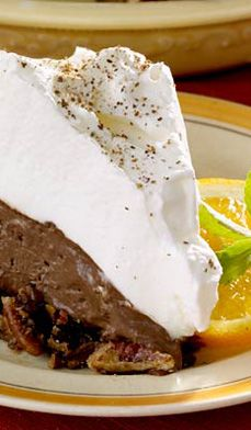 This mousse-like Chocolate Orange Pie will leave guests begging for more. Prepare the crust first, and chill for an hour before adding the filling. Cool 1 more hour, and it's ready to enjoy! #recipes #christmas #thanksgiving #desserts #holiday