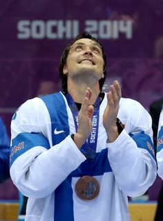 Bronze medalist Teemu Selanne #8 of Finland celebrates during the medal ceremony after defeating the United States 5-0 during the Men's Ice Hockey Bronze Medal Game (c) Getty Images