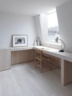 Loft study with long built-in desk and frameless wrap-around window. Ingersoll Road by McLaren Excell. #minimalism