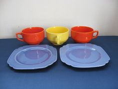 Homer Laughlin Riviera Three Red and Yellow Cups and Two Mauve Blue Bread and Butter Plates