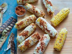 Grilled Corn with Lime Butter : Tyler first soaks corn in water before putting the cobs on a hot grill. The corn is done when it feels soft to the touch. Take the corn off the grill and carefully peel back the husks and remove the silks. Tie each husk in a knot so you can hold on to it like a handle; roll each cob in lime butter and queso fresco, then sprinkle with homemade Ancho Chile Rub.