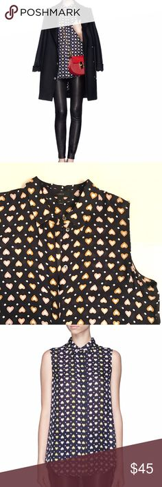 J. Crew silk sleeveless blouse in heart dot Navy blue with multi-color hearts and white dots. Semi-sheer silk. Curved high-low shirt-tail hem with concealed button front placket. 100% Silk. Loose, floaty fit. Great layering piece. Excellent condition. J. Crew Tops Blouses