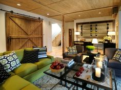 barn door sliding to hide storage area? Love the warmth of the wood and the great hardware