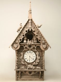English Folk Art Dove Cote with Clock    We found this exceptional piece on England's south coast sitting atop a horse stable behind a manor home. Folky carving includes farm animals and a farming family. Constructed at the beginning of the 20th century and later restored in the 1950s.