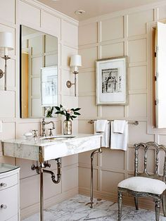 what a beautiful bathroom!  Marble sink and floor, paneled walls