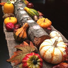 Easy thanksgiving table decor. Find a branch, cut to desired length, drill holes for candles and decorate with desired accessories.