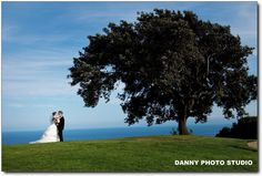 Bride and Groom on our signature 15th green www.countryclubreceptions.com