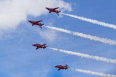 RAF Red Arrows in BAE Hawk T1 trainers Farnborough International Airshow Farnborough Airport Rushmoor Hampshire England  www.alamy.com/image-details-popup.asp?ARef=FC323Y  #raf #red #team #jet #airplane #air #plane #display #aviation #airshow #force #hawk #arrows #flight #aerobatic #formation #sky #smoke #aircraft #royal #show #teamwork #military #flying #speed #fast #stunt #british #pilot #wing
