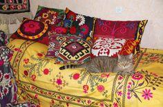 decorative suzani pillows in interior…. uzbek ethnic textiles, silk embroidery….