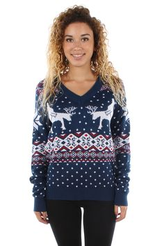 What do reindeer do when they aren't on sleigh duty? This naughty V-neck Christmas sweater shows one possibility: all reindeer orgy, all the time!