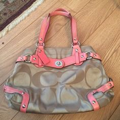 Coral and tan Coach bag Coral interior with 2 phone pockets and 1 zipper pocket. Gently used. Like the bag but not the price? Make an offer! Coach Bags