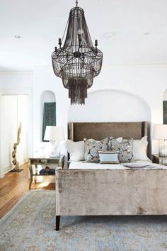 Beautiful bed and throws. Great color. Dramatic chandelier