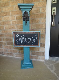 Hanging chalkboard welcome signpost