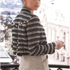 So want this Chanel tweed jacket..with the pearl detail on the back.