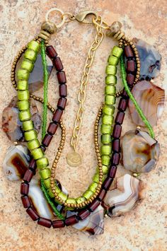 This chick can design!!!  Custom Necklace: Gorgeous Banded Agate Slice, Green Glass, Brown Buri Seed and Bronze Multi-Strand Necklace