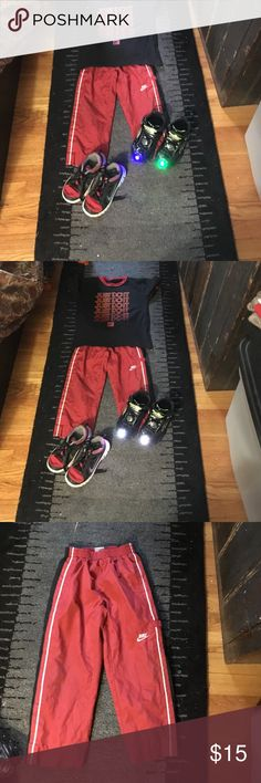 "Nike boys warm up pants size 4 Red/black/white with gray mesh lining and side pockets as well as lower Velcro ""cargo"" pocket - great pants for kids my boys loved!! Nike Bottoms Sweatpants & Joggers"
