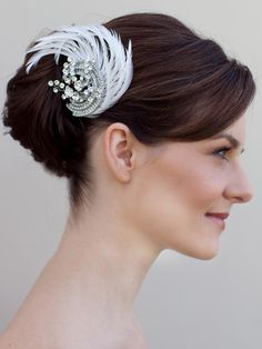 Hair Comes the Bride - Rhinestone Bridal Clip with Feathers ~ Demi, $87.00 (http://www.haircomesthebride.com/rhinestone-clip-with-feathers-demi/)
