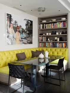 In the breakfast area, a banquette upholstered in a chartreuse embossed vinyl is paired with a cheeky photograph of Barbie and Ken by David Parise for added personality.