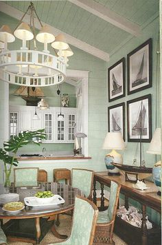 Gorgeous coastal home with cathedral ceilings. Love the lighting, the seafoam green bead boards, and the large pass-through window from the kitchen