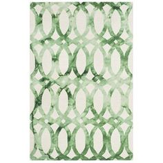 Artfully handcrafted from wool, this rug showcases a bold geometric motif in ivory and green. #wool #rug #handcrafted