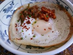 Sri Lankan egg hopper recipe. These are delicious! Eggs are poached in a coconut milk and fermented rice flour batter.