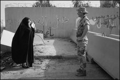 An American soldier being photographed by a Kuwaiti woman. Gulf War, Kuwait, 1991.    [Credit : Abbas]