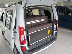 The folded QUQUQ fits neatly in the back of a number of vans