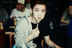 He doesn't have his jacket on all the way and his mouth is full of food. This is too adorable. I love Chanyeol! <3