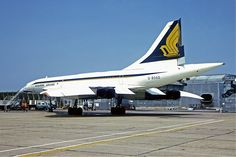 Singapore Airlines Concorde. Joint operated with British Airways, this aircraft had each of the company livery painted on each sides.