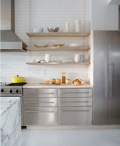 In Good Taste:Jean Allsopp Photography - Design Chic - amazing kitchen - love the open shelving and stainless cabinets and marble island!