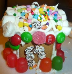 Gingerbread House  http://creativewithkids.com/gingerbread-houses-day-9-creative-christmas-countdown/