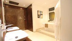 A luxury bathroom and wetroom with rust coloured mosaic and contrasting large porcelain floor tiles Tiles Uk, Mosaic Tiles, Floor Preparation, Latest Bathroom Designs, Wet Room Shower, Large Format Tile, Tile Showroom, Tile Stores, Tile Installation
