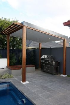 30 Grill Gazebo Ideas to Fire Up Your Summer Barbecues The solid roof of this grill gazebo has a small pergola style overhang near the pool edge, and features an L shaped wooden bench to one side. Modern Pools, Pool Designs, Small Pergola, Portable Gazebo, Outdoor Kitchen Design, Modern Patio, Patio Design, Skillion Roof, Modern Gazebo