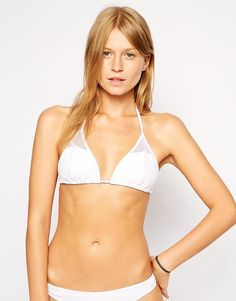 Bikini top by French Connection Stretch, swim fabric Soft, sliding cups for adjustable coverage Removable, light cup padding Halterneck style Sheer, mesh inserts Self-tie string fastenings for an adjustable fit Machine wash 80% Polyamide, 20% Elastane