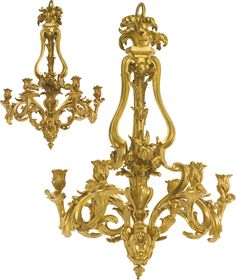 A pair of Louis XV style gilt bronze six-light chandeliers,France, late 19th/early 20th century, in the manner of Jacques Caffiéri.