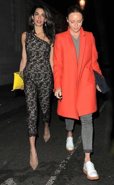 Stellar Stella from Amal Clooney's Best Looks  Amal hits the London nighttime scene with Stella McCartney in a lacy jumpsuit from the designer's own collection.