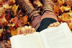 Reading in leaves girl outdoors autumn leaves book boots read