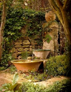 I like this rustic water feature cobbled together from large mixing bowls and a simple water spout.  My idea to turn it into a birdbath is to put screen one to two inches below water, seal with waterfall sealing spray, cover with river rocks. Hummingbirds and finches would love it.