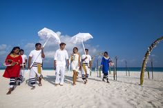 Love at the water's edge. A Maldivian Bodu Beru procession leads you to your magnificent beachfront location. Delicious wedding cake, luxurious Champagne, a bridal bouquet of tropical island blooms. Create memories that last forever during a renewal of vows in the Maldives. #Wedding #Honeymoon #RenewalofVows #VelassaruMaldives