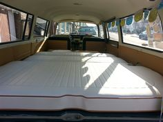 Volkswagen T2a Baywindow interior - fold down bed. Upholstery by Delilah's VW Upholstery. Bed by Rusty Lee