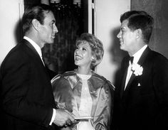 AR6437-D. President John F. Kennedy with Dinah Shore and George Montgomery at the Radio and Television Correspondents Association Dinner